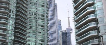TORONTO, ON - MARCH, 17   Condo buildings clog the downtown core where the CN tower is often obscured from the street.  This is at the corner of Yonge street and Queen's Quay.  condo apartment housing balcony living downtown        (Richard Lautens/Toronto Star via Getty Images)