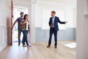 Realtor Showing Hispanic Couple Around New Home